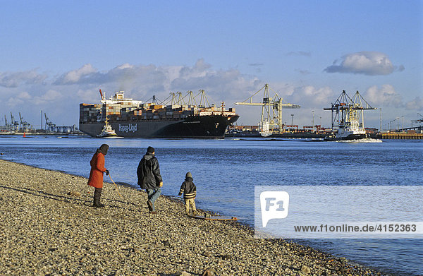 Huge container ship on river Elbe at Hamburg Germany