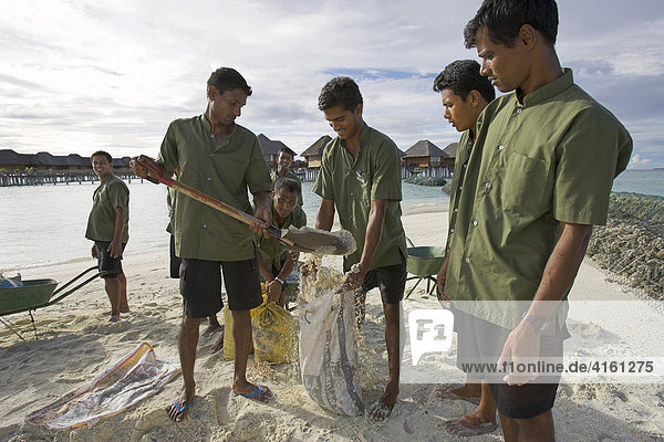 Maldivians fortify the sandy beaches as a protection from Tsunamies and current  Maldives.