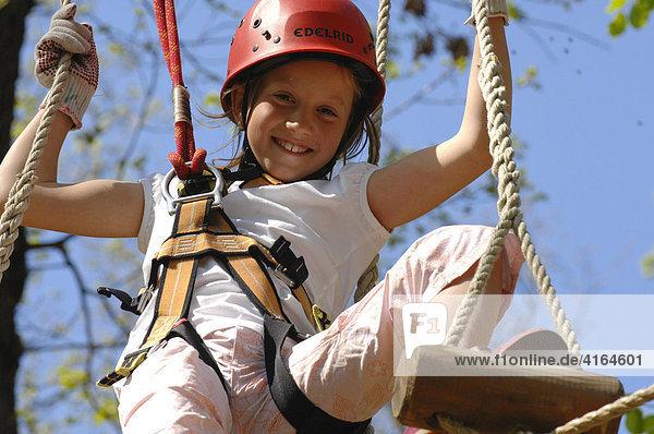 Girl with climbing equipment  Climbing forest Neroberg  Wiesbaden  Hesen  Germany