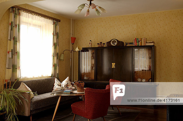 1950s living room with cabinet  sofa  armchair  lamp and table  Lauf an der Pegnitz  Middle Franconia  Bavaria  Germany  Europe
