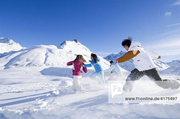 Children having a snowball fight  Galtuer  Tirol  Austria  Europe