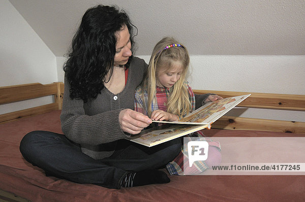 Mother with child  10 years old  reading a book
