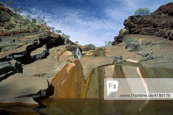 Colourful waterfall  Hamersley Gorge  Karijini National Park  Western Australia  Australia  Oceania