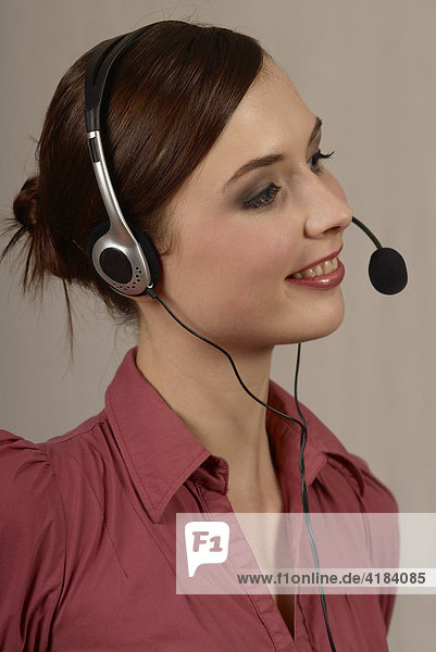 Young woman with a headset  call center  telephonist