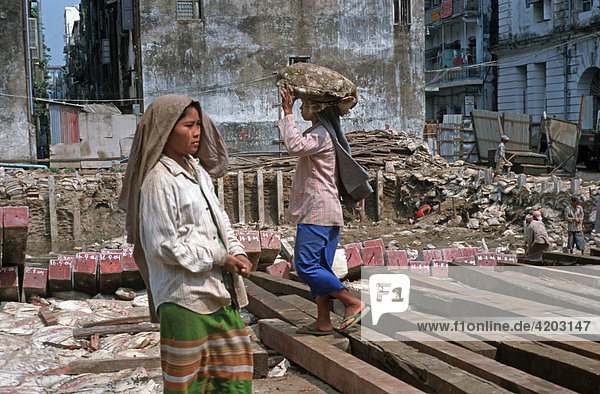 Female day labourer on a building site in Yangon  Burma