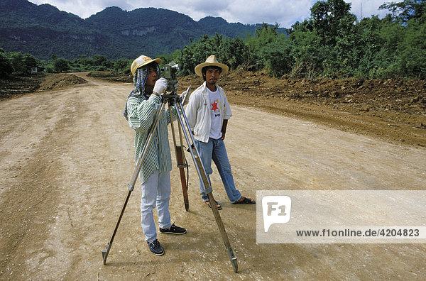 Construction of a road going through a rainforest  deforestation  Thailand  Southeast Asia