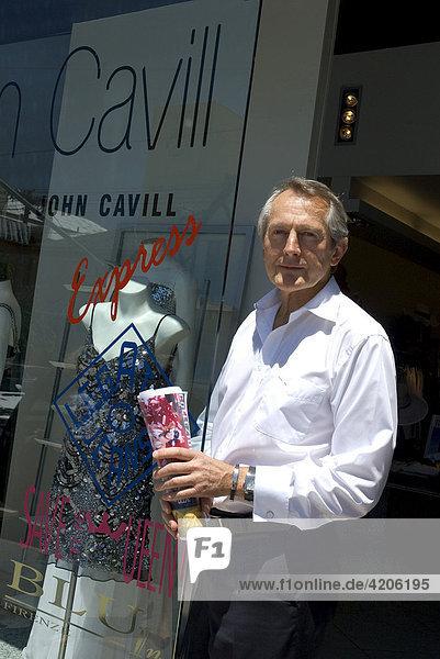 Fashion designer John Cavill in front of his shop  Melbourne Victoria  Australia