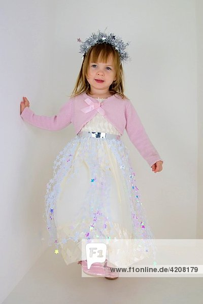 2 years old girl dressed as a star princess.