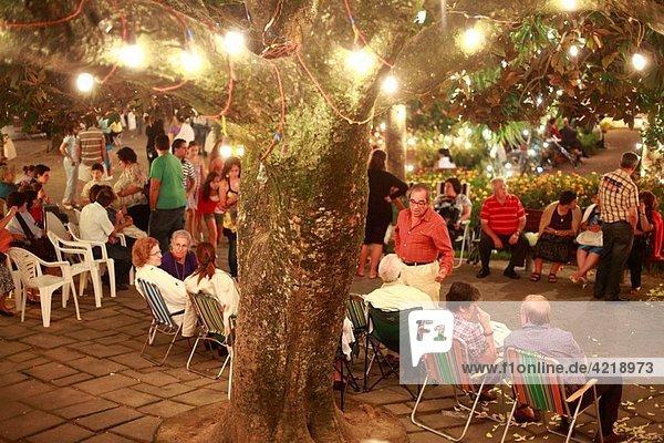 Local people enjoy a night out during Senhor Bom Jesus da Pedra fest Vila Franca do Campo  Sao Miguel island  Azores