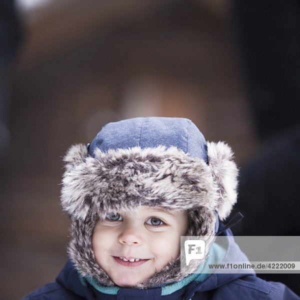Boy in fur hat