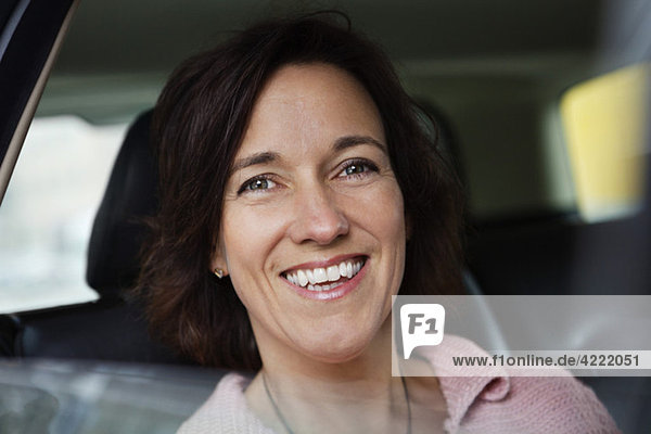 Closeup on happy woman in car