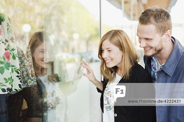 Two looking through display window