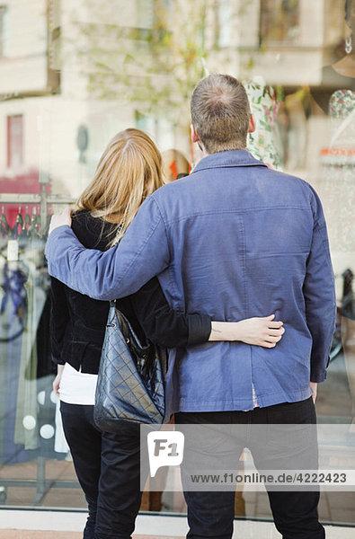 Couple holding around back