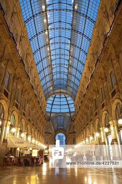 Vittorio Emanuele II Shopping Gallery in Milan  Italy illuminated at night