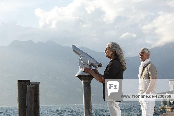 Senior couple looking on water  Italy  Malcesine