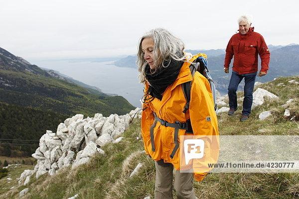Senior couple hiking in mountain range  Italy  Monte Baldo