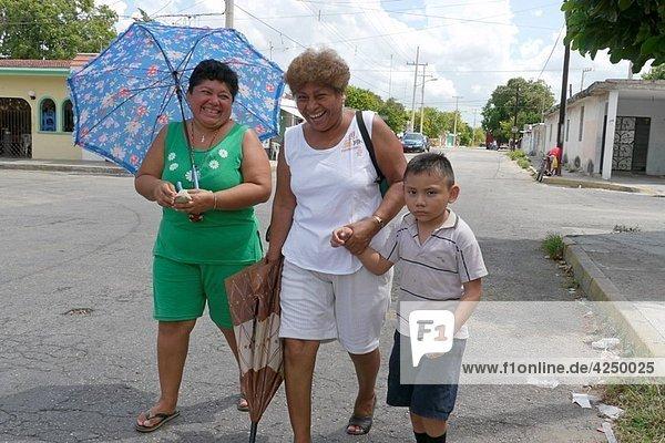 MEXICO Women and boy  Merida  Yucatan photo by Sean Sprague