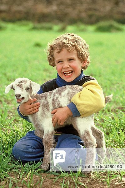 Little kid and goat