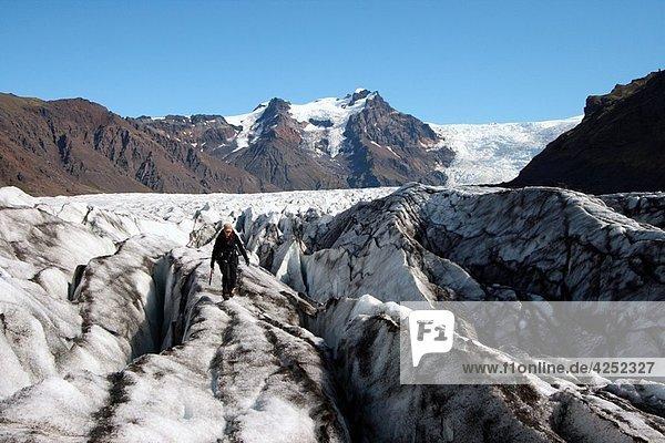 Climbing ice in Vatnajokull glacier Iceland