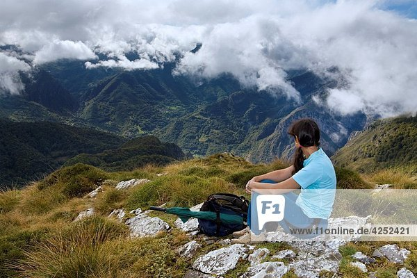 A woman practicing mountaineering in the Cornion massif  in the Picos de Europa National Park  Sajambre Valley  Leon  Castilla y Leon Spain