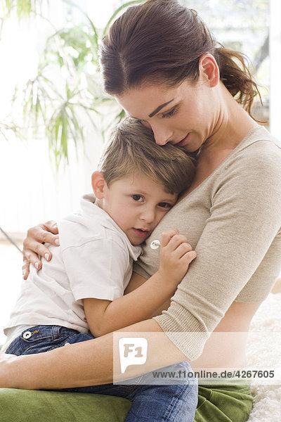 Mother hugging sad son
