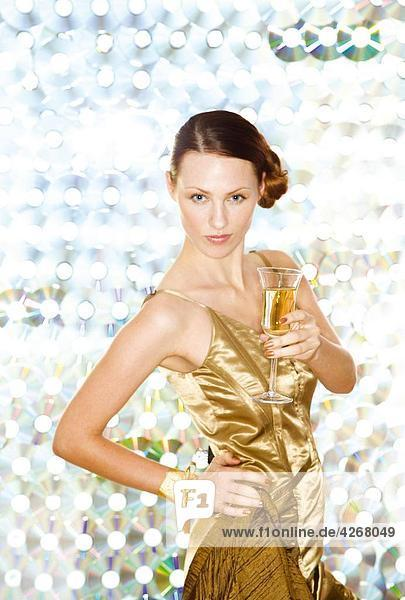 Woman in golden dress at party
