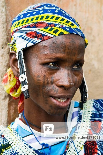 A Peul / Fulani woman wearing a traditional hat. photo taken in Benin.