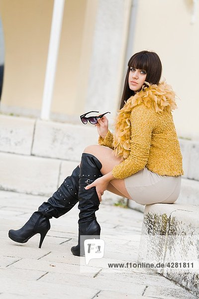 High boots on a young woman