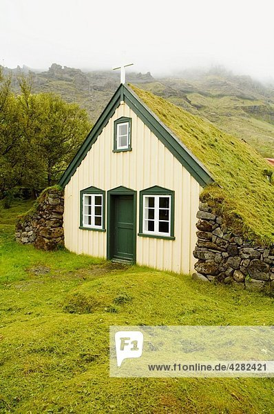 Iceland  Litlahof  little village  one of the last traditional churches.