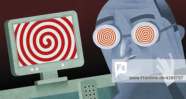 Hypnotisierter Mann am Computer
