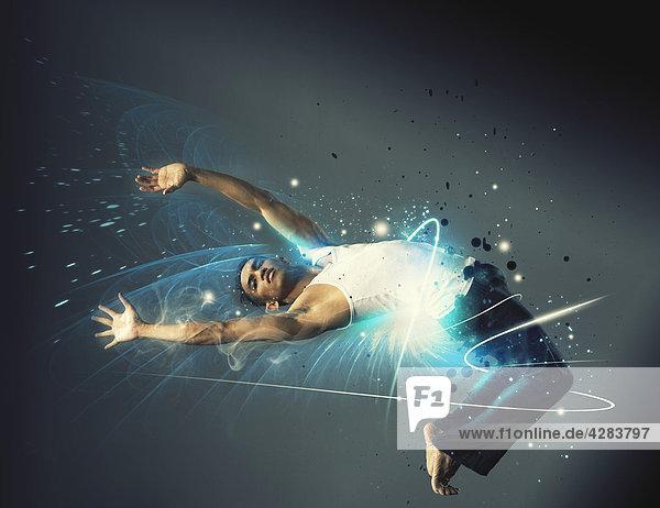 Elastischer Mann tanzt und glüht Elastischer Mann tanzt und glüht