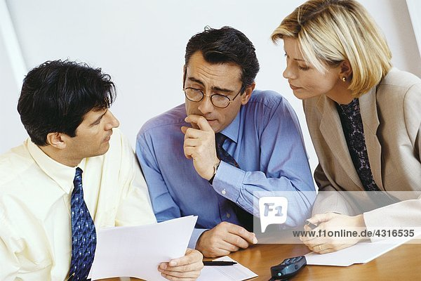 Business colleagues studying document