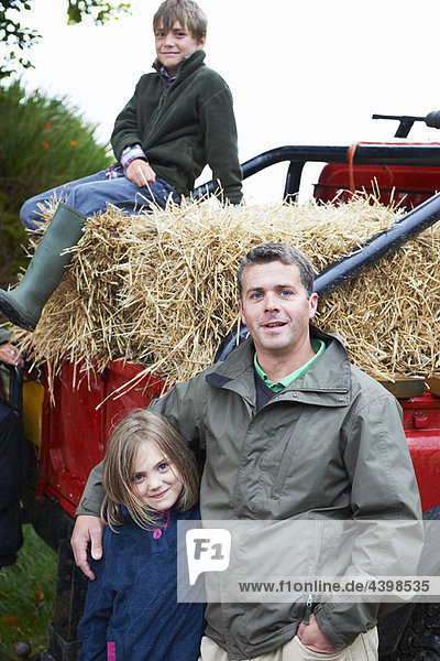 Father and children with 4x4 landrover