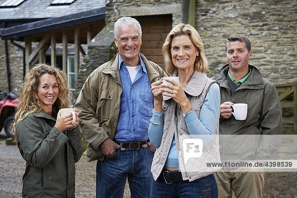 Family having tea on the farm