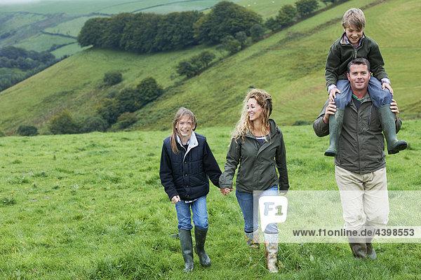 Family walking in the fields Family walking in the fields