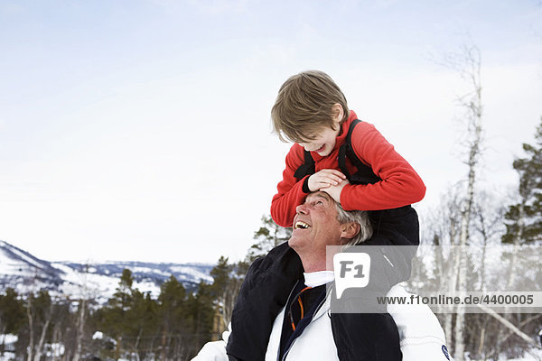 Grandson and grandfather smiling