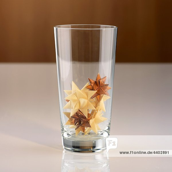 Star bows (made from gift ribbon) in a glass