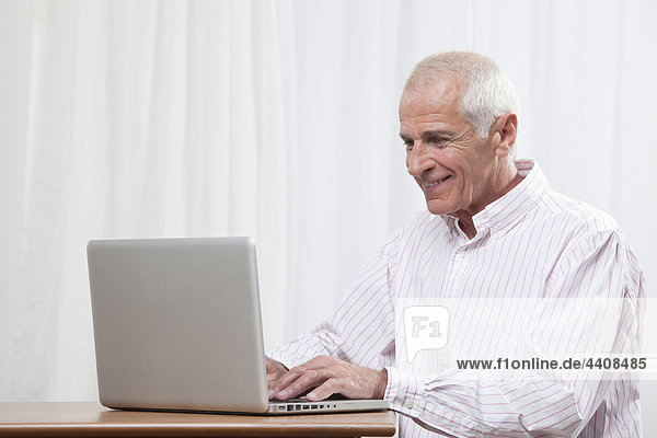 Man using laptop  smiling