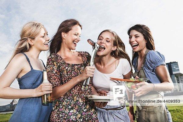Women enjoying beer and sausages