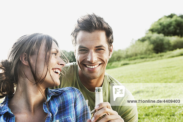 Man and woman enjoying beer