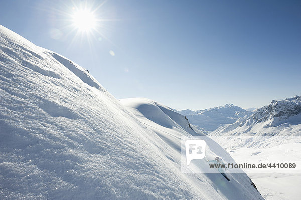 Austria  Woman skiing on arlberg mountain