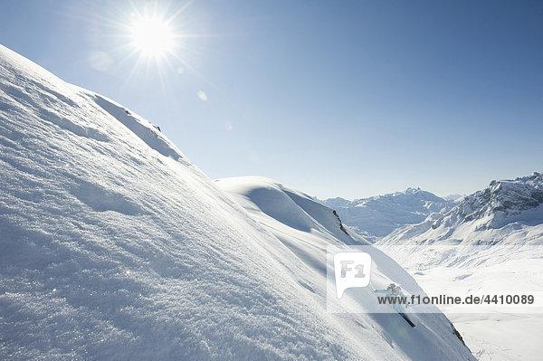 Austria  Woman skiing on arlberg mountain