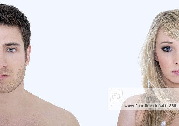 Junges Paar vor weißem Hintergrund  Portrait