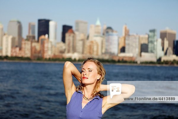Young woman on a ferryboat  Manhattan  New York  USA