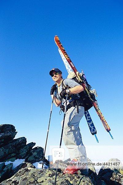 Telemark skier standing on mountain peak
