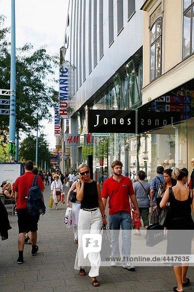 People walking at Mariahilfer strasse shopping street  Vienna  Austria