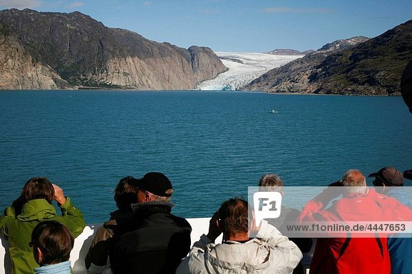 People watching the Arsuk Glacier in Arsuk Fjord  Greenland