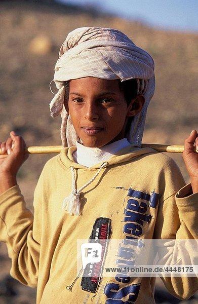 Portrait of a young goat shepherd  near Salalah. Dhofar region. Oman.