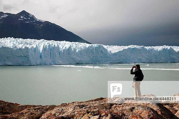 Man taking picture of the Perito Moreno glacier Los Glaciares National Park  El Calafate area  Santa Cruz province Patagonia Argentina