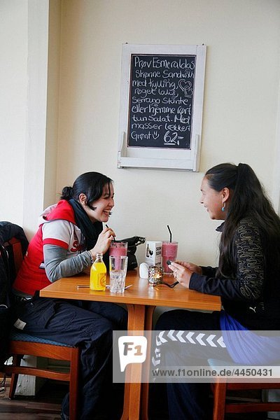Young women sitting at Esmeralda Cafe and Restaurant in Nuuk  Greenalnd